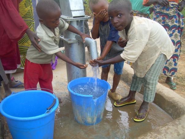 Copy of 7004 - NIGERIA 2 BOYS AT SPIGOT